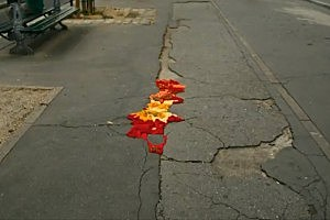 Artist Covers Potholes in Paris With Knitwork